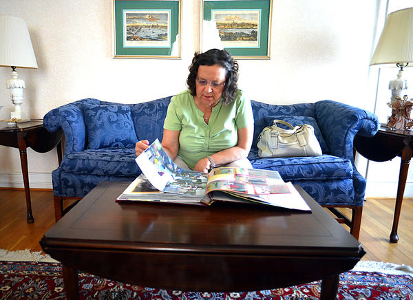 Linda Middlekauff flips through a scrapbook of events held at the Women's Club on S. Prospect Street. She was enjoying a house and garden tour in Hagerstown.