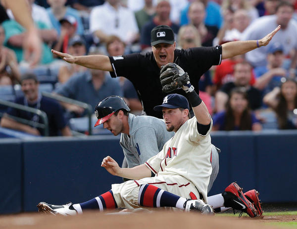 Washington's Stephen Lombardozzi (1) is called safe at third base by umpire Tony Randazzo as Atlanta third baseman Chris Johnson holds up the ball on Saturday during the fourth inning of the Nationals-Braves game.