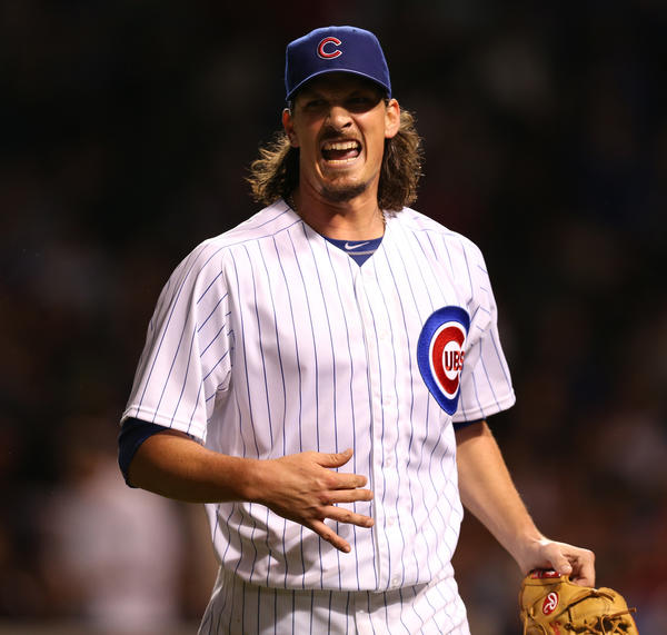 Cubs starting pitcher Jeff Samardzija talks with one of his teammates as he walks to the dugout after retiring the Diamondbacks in the 5th inning.