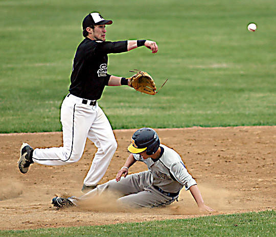 Former Aberdeen Smittys player, Brendon Hoellein, will step into a coaching position with the Warner-Ipswich-Northville Legion team this summer. Hoellein is pictured making a throw to complete a double play in an American Legion game at Fossum Field.