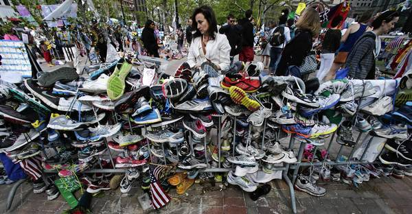 A memorial near the finish line of the Boston Marathon, pictured on the one-month anniversary of the bombing. A fund for the victims has raised $38 million so far.