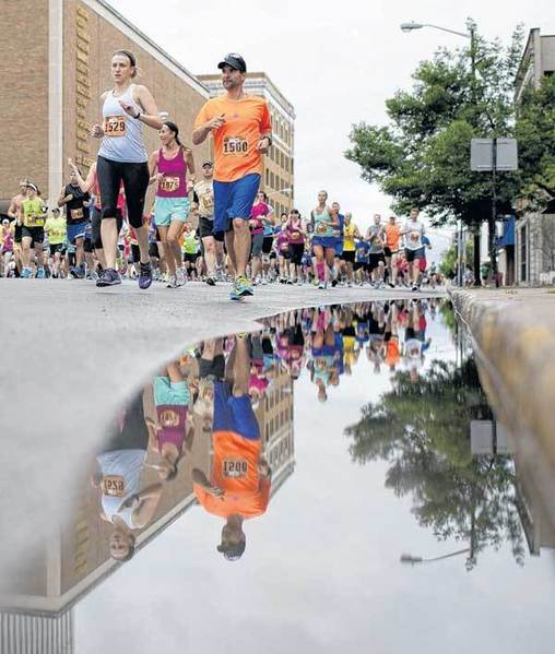 Runners make their way north along Lafayette Boulevard in downtown South Bend on Saturday during the Sunburst half-marathon.