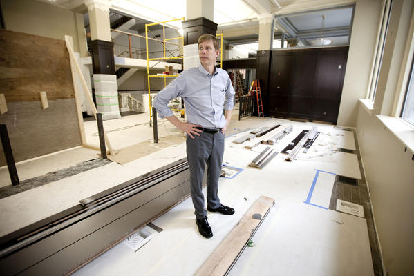 Kurt Janowsky, owner of The Exchange and Caf Navarre, surveys the progress inside of the former Wells Fargo bank building in downtown South Bend. Part of the first floor will open later this summer as The Exchange, a whiskey bar.