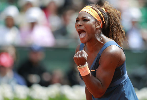 Serena Williams reacts during her women's singles match against Roberta Vinci of Italy at the French Open tennis tournament at the Roland Garros stadium in Paris.