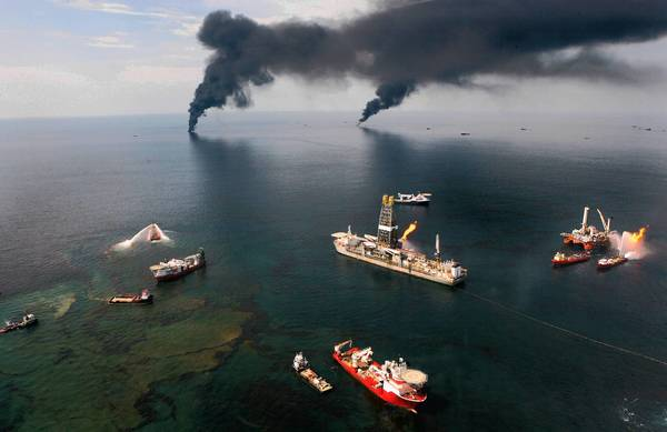 Fires burn around the site of the BP Deepwater Horizon rig site in the Gulf of Mexico, June 19, 2010.