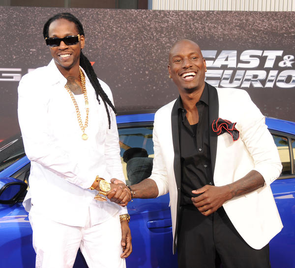 """Rapper 2 Chainz and actor Tyrese Gibson arrive at the Los Angeles premiere of """"Fast & The Furious 6"""" at Gibson Amphitheatre on May 21, 2013 in Universal City, California."""