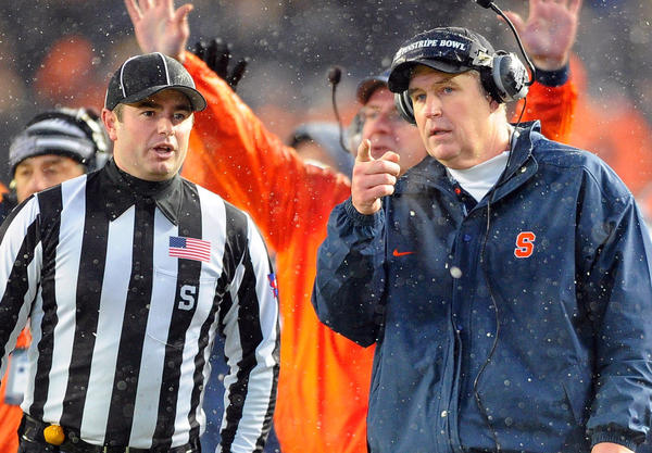 Syracuse Orange head coach Doug Marrone speaks with an official during the second quarter against the West Virginia Mountaineers at the 2012 New Era Pinstripe Bowl at Yankee Stadium.