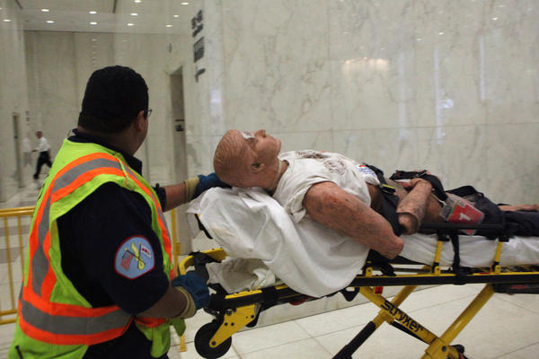 Jesus Gutierrez, a Chicago Fire Department paramedic, transmits a mannequin during the full scale simulated high rise fire and evacuation drill conducted at AON Center in downtown Chicago on Sunday. The drill lasted for about two hours and about 200 fire fighters, paramedics, and volunteers participated in the evacuation drill.