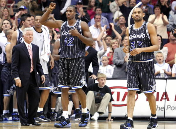 Dwight Howard, left, and Grant Hill walk off the court after the Orlando Magic defeated the Boston Celtics at the Amway Arena in 2007. (Jacob Langston/ Orlando Sentinel file)