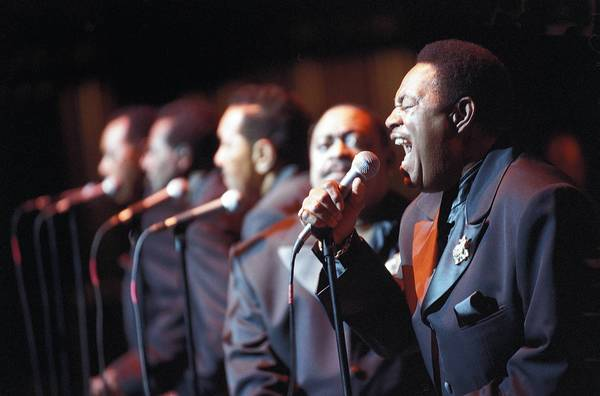 Marvin Junior, right, and the Dells perform at the Arie Crown Theatre in 2003, celebrating their 50th anniversary.