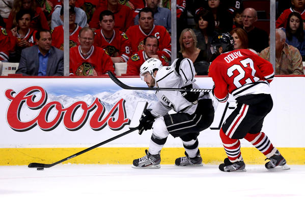 Kings' Drew Doughty, left, carries the puck past the Blackhawks' Johnny Oduya, who is usually a second-unit defenseman on the penalty kill.