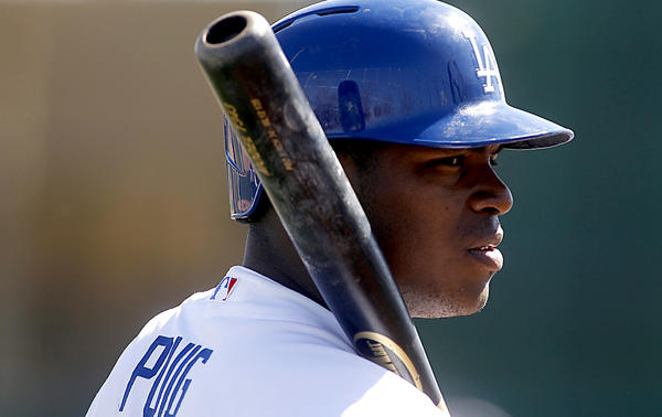 Dodgers outfielder Yasiel Puig takes batting practice during spring training.
