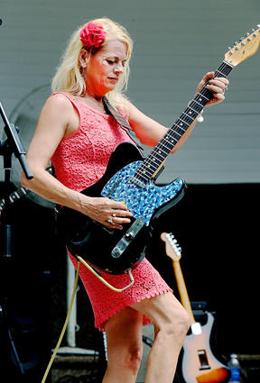 Skyla Burrell plays the guitar during her band's performance Sunday at Blues Fest in the Park in Hagerstown.