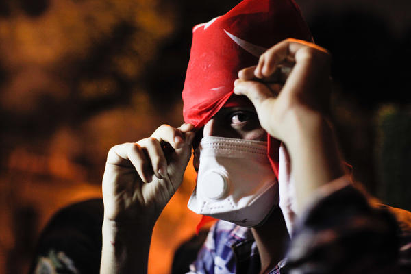 A protester takes part in a demonstration near Turkish Prime Minister Recep Tayyip Erdogan's office in Istanbul.