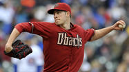 Left-hander <b>Patrick Corbin</b> became the major leagues' first nine-game winner, laboring through six innings Sunday in the Arizona Diamondbacks' 8-4 win over the Chicago Cubs at Wrigley Field.