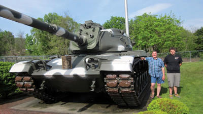 Barry Jerley and his nephew Brad Jerley pose by the tank they recently refurbished in Windber Veterans Park. After completing the tank, the men will now take on the project of painting the two cannons in the park.