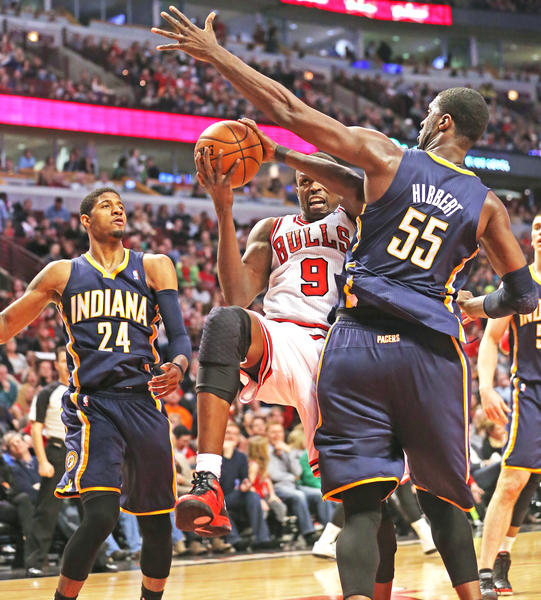 Luol Deng goes to the basket against the Pacers' Roy Hibbert during the second half of a game in March.