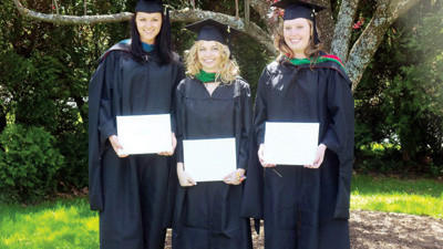 From left: Kara Yutzy, Kendra Stanton and Jessica Livengood after their St. Francis University graduate school commencement May 5. This was their fourth graduation together.