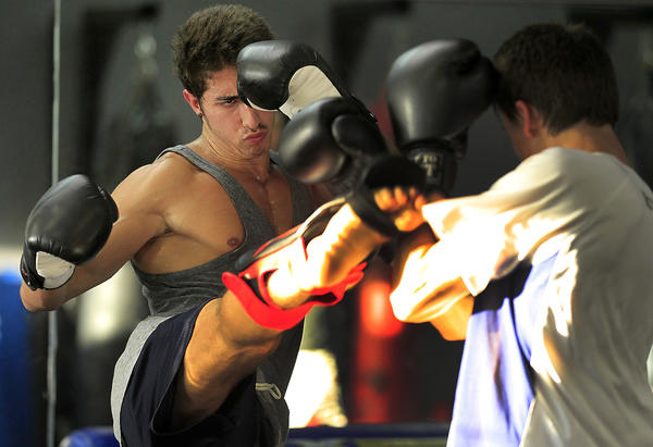 Samer Hamwi, 20, left, places a kick near the head of sparring partner Nick Matute, 18, right, at the Shark Tank MMA Gym.