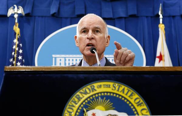 Gov. Jerry Brown responds to a question concerning his revised 2013-14 state budget plan during a news conference at the Capitol on May 14.
