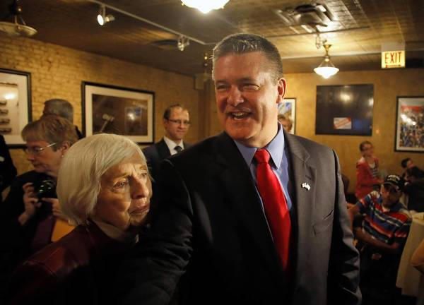 State Treasurer Dan Rutherford greets supporters after announcing his GOP candidacy for governor Sunday at Harry Carey's restaurant in River North.