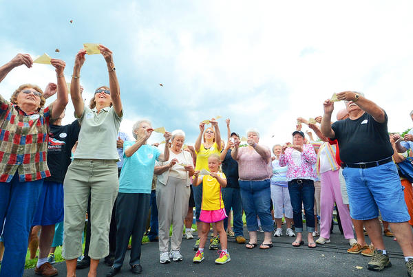 Cancer survivors and family members release butterflies at the annual Celebration of Life picnic Sunday at The Improved Order of Red Men Tribe 84 grounds along Lappans Road in Williamsport.