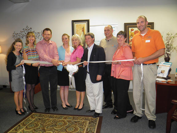 From left, ready to cut the ribbon, are Kelly Brunner from Right at Homes Hagerstown office; Carole Luber, co-owner of Right at Home; Hagerstown Mayor David S. Gysberts; Jean Long of Right at Home; Eileen McLaughlin, co-owner of Right at Home; Brien Poffenberger, president of the Hagerstown-Washington County Chamber of Commerce; Steve Luber, co-owner of Right at Home; Julianna Albowicz, representative for U.S. Sen. Barbara Mikulski, D-Md.; and Ryan Burns from Right at Homes Hagerstown office.
