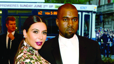 "NEW YORK, NY - MAY 06: Kim Kardashian and Kanye West attend the Costume Institute Gala for the ""PUNK: Chaos to Couture"" exhibition at the Metropolitan Museum of Art on May 6, 2013 in New York City. (Photo by Larry Busacca/Getty Images)"