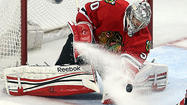 In one of his many bold moves Sunday night, Blackhawks goalie Corey Crawford ventured 10 feet out of the crease as the puck dangerously veered toward him.