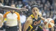 Tulsa Shock rookie and former Notre Dame standout Skylar Diggins drives to the basket during Sunday¿s WNBA game against the Chicago Sky.