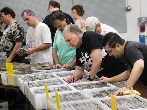 Music collectors shop at the Lehigh Valley Music Expo at Allentown's Merchants Square Mall.