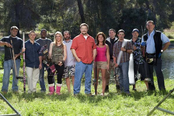 "Host Reno Collier, in orange shirt at center, and the cast of Animal Planet's ""Top Hooker."""