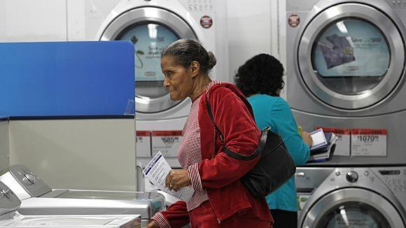 A customer at a Sears store in Chicago looks over washing machines.