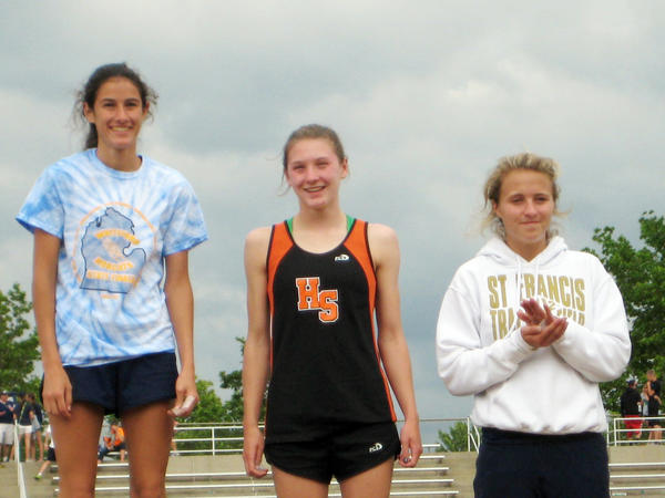 Harbor Springs sophomore Salix Sampson (middle) finished second in the Michigan High School Athletic Association Division IV state finals in the 200-meter dash in 26.98 seconds Saturday at Hudsonville. Miranda Johnson (left) of Ottawa Lake-Whiteford won the race in 25.94, while Lauren Buckel of Traverse City St. Francis was third in 27.02.