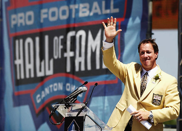 Jim Kelly waves to the crowd before he gives his speech at the Pro Football Hall of Fame in 2002.