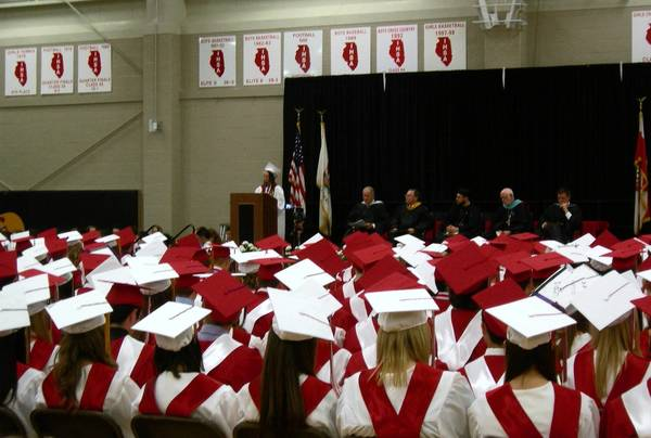 Graduating seniors at Benet Academy in Lisle listen to a speaker after honoring a 17-year-old classmate who died last week when she was struck by lightning.