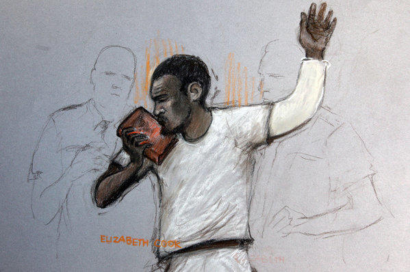 In this courtroom sketch, suspect Michael Adebolajo kisses the Koran as he appears at Westminster Magistrates Court in London. He is accused of killing British soldier Lee Rigby in an attack that prompted Prime Minister David Cameron to launch an investigation of Islamic radicalization in Britain.