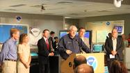 Craig Fugate, FEMA chief, speaks at a press conference at the hurricane center.