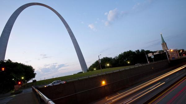 Traffic passes the Gateway Arch on I-70 in St. Louis.