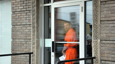 William Henry Ulderich heading out the door at the Windber Magisterial Office after he waived his right to a preliminary hearing in two arson cases.