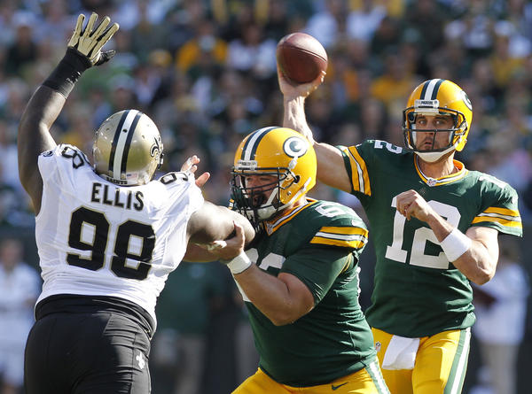 New Orleans Saint Sedrick Ellis rushes Green Bay Packers quarterback Aaron Rodgers in September.