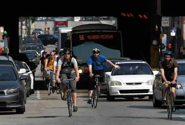 "Fines for riders who violate traffic laws would at least double, to a minimum of $50 and maximum of $200 from a current fixed amount of $25. Drivers and passengers who ""door"" a cyclist would face a $1,000 fine, twice the current amount of $500."