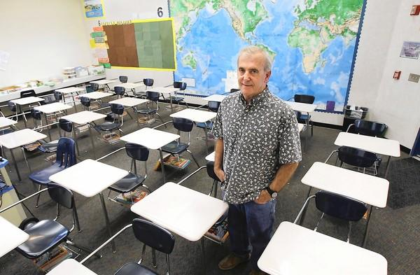 Longtime Laguna Beach teacher Tom Purdy stands in his Thurston Middle School classroom. Purdy will retire this year after spending his whole career working in the Laguna Beach Unified School District.