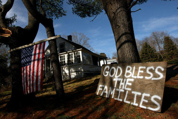 In the days following the shooting, this sign stood in front of a home near Sandy Hook Elementary in support of the families who lost loved ones in the rampage. The Connecticut attorney general has cleared the way for donations to be distributed to families and the community.