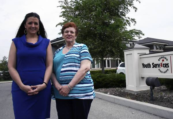 After about 24 years of service, Nancy Bloom, right, is stepping down from her responsiblities as the executive director of Youth Services of Glenview/Northbrook to Amy O'Leary, left. The two posed outside of the organization's headquarters in Glenview on May 20.