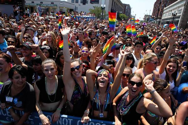 Spectators cheer for beads during the 43rd Annual Gay Pride Parade on Chicago's North Side, June 24, 2012.