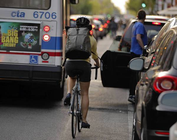 """Drivers and passengers who """"door"""" a cyclist — causing an accident by opening a door in the path of the bike — would face a $1,000 fine, twice the current $500."""