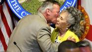 Luisa Medina gets a kiss from Orlando Mayor Buddy Dyer