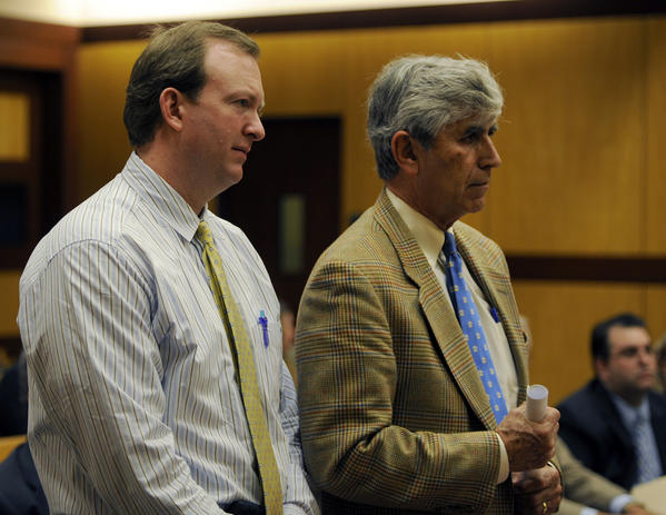 Dr. Scott Houghton, left, stands with his attorney, William Dow, as he makes his first court appearance since being arrested on April 12, 2011, on 47 felonies involving prescriptions, at the Middlesex Superior Courthouse in Middletown.
