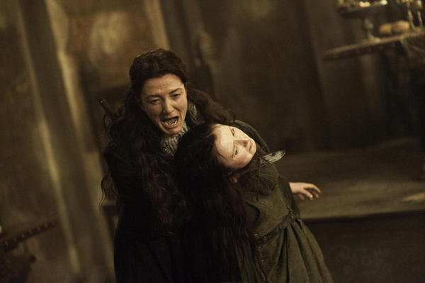 Catelyn Stark (Michelle Fairley, left) makes a desperate attempt to save her son's life.